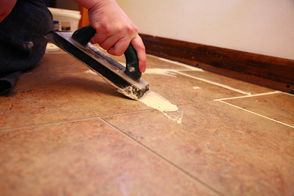We Used A Vinyl Grout Made Specifically For Vinyl Tiles. Using A Grout  Float, We Pushed Grout Into The Grout Lines, Then Carefully Scraped Extra  Grout From ...